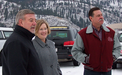 New mill owner Mike Boehme, Commissioner Jean Curtiss, and owner Steve Nelson